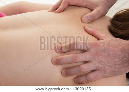 Deep Tissue Massage On A Woman's Shoulder Blade