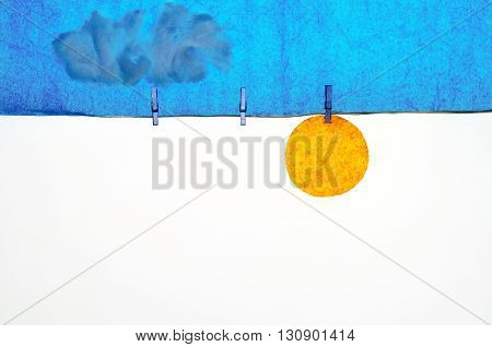 composition with clothes pegs and a fake sun and sky