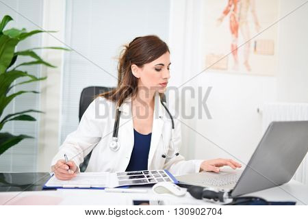 Doctor at work in her office
