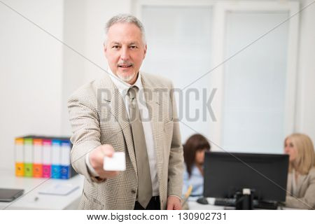 Businessman giving a business card