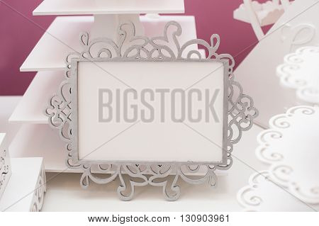 Vintage white frame on a table and place for text.