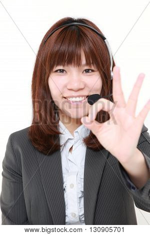 young Japanese business woman showing perfect sign