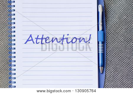 Attention text concept write on notebook .