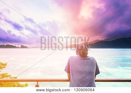 a girl looking to colorful fancy sky, soft focus, vintage tone