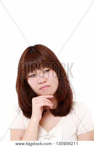 portrait of portrait of young Japanese woman worries about something on white background