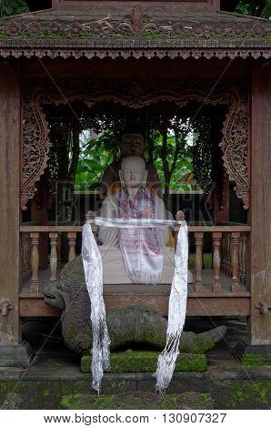 two buddha statues in mendut buddhist monastery