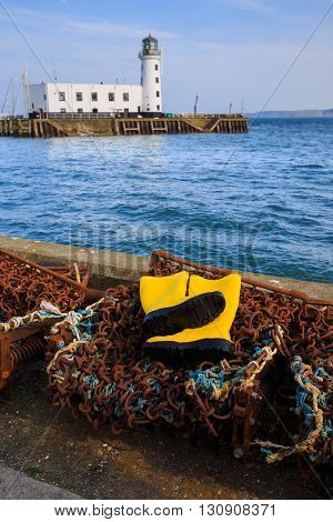 SCARBOROUGH ENGLAND - MAY 5: Trawlerman's protective yellow boots and fishing gear in the harbour. In Scarborough England. On 5th May 2016.