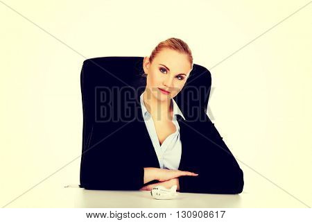Business woman with airplane toy on the desk