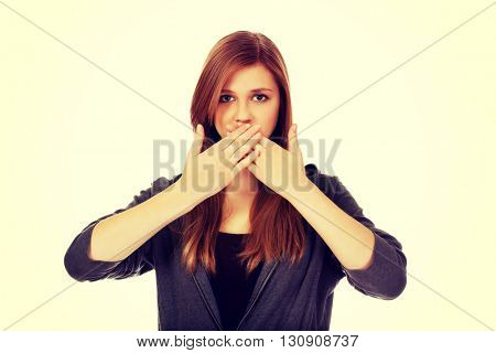 Teen woman covering her mouth with both hands