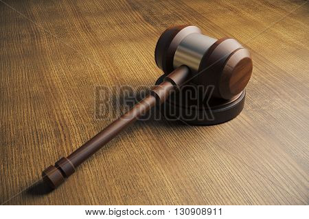 Side view of judges gavel on wooden desktop. Close up 3D Rendering