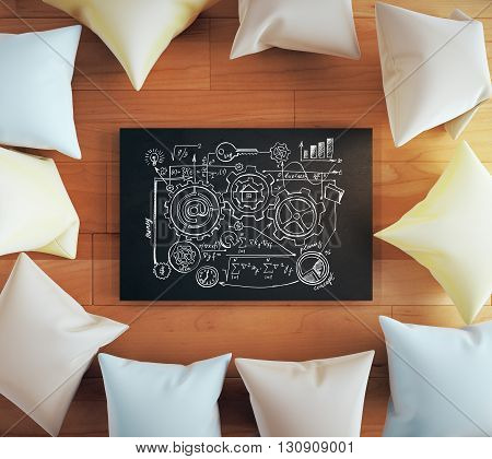 Teamwork concept with gears sketch on blackboard surrounded with colorful pillows on wooden floor. 3D Rendering