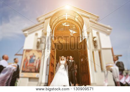 Pair Of Hands Releasing White Doves Of Wedding Couple During Sunset