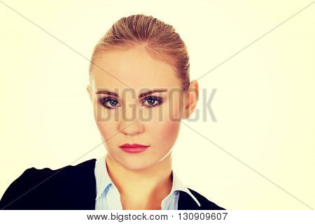 Young worried and sad business woman