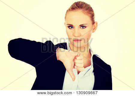 Unhappy business woman with thumb down