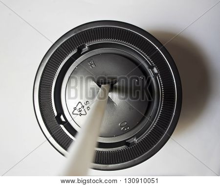 Recycle symbol on Plastic cap of cup