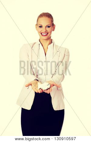 Beautiful business woman holding airplane model