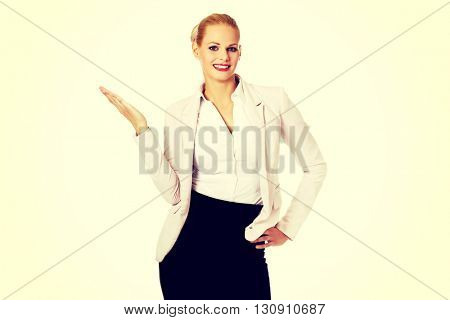 Business woman pointing for copyspace or something