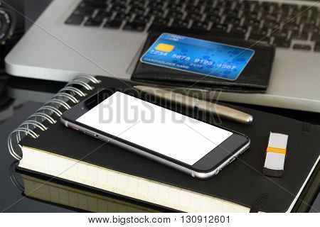 office desktop with copy space on mobile phone and plastic card