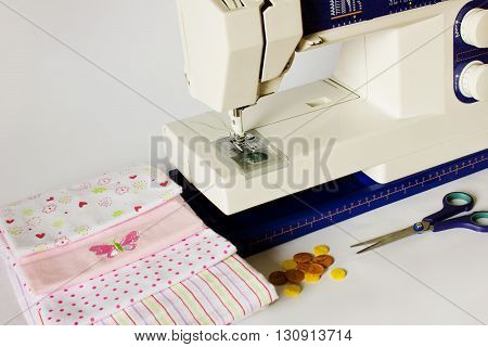 Sewing machine and sewing items. Workplace seamstress.