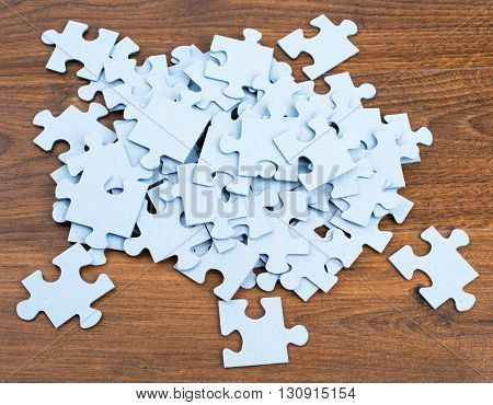 Pile of puzzle pieces on table, top view