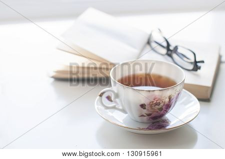Cup Of Tea, Old Book And Glasses