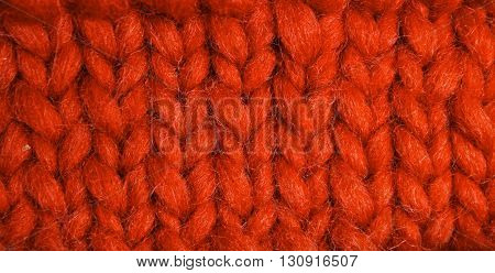 Sample of knitting with soft yarn. Texture of knitting closeup.