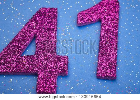 Number fortyone purple color over a blue background. Anniversary. Horizontal