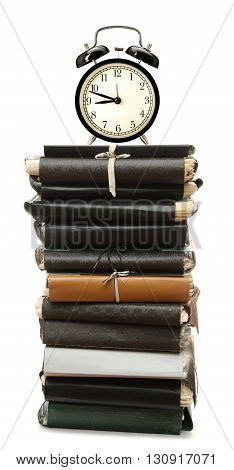 Stack Of Paper Folders And Alarm Clock