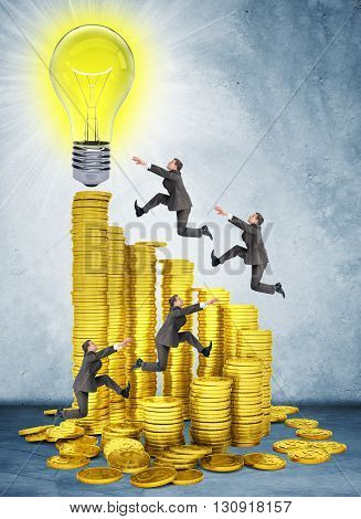 Businessmen run and jump on money stairs to light bulb on top