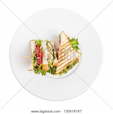 Traditional grilled club sandwich with chicken and tomatoes. Isolated on a white background.