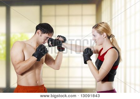Couple Fight. Woman Fighter Punching Man