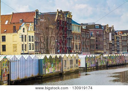 Amsterdam, Netherlands - March 31, 2016: Flower market street view in Amsterdam canal in Holland