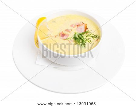 Clam chowred soup with roast bacon and fresh dill. Isolated on a white background.