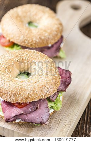 Bagel (with Roast Beef) On Vintage Background
