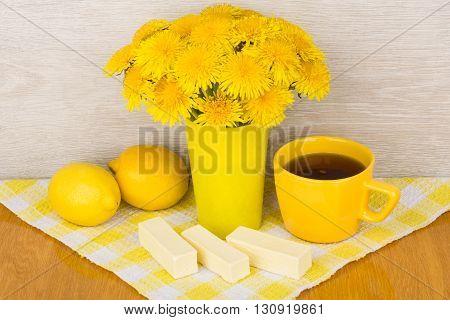 Tea, Lemon, Candy And Bouquet Of Dandelions