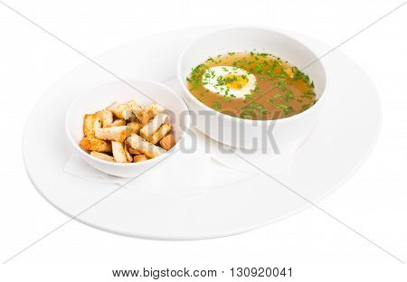 Chicken bouillon with egg and crumbs. Isolated on a white background.