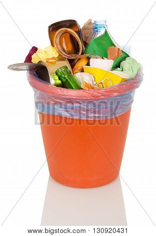A bucket filled with household waste and food isolated on white background.
