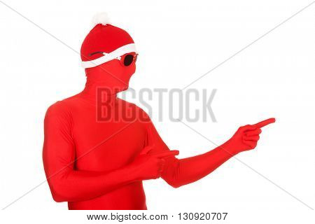 Portrait of santa man in latex clothing pointing