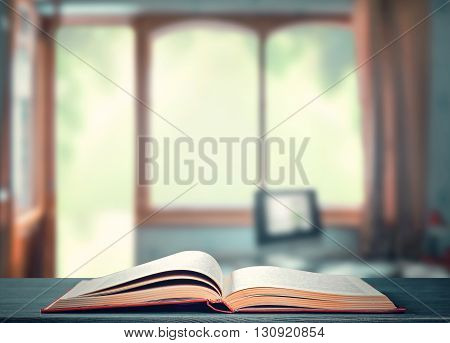 An open book on a desk in the room