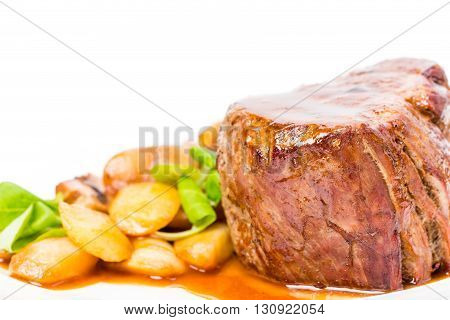 Delicious beef steak in demiglas sauce with vegetable garnish. Macro. Photo can be used as a whole background.