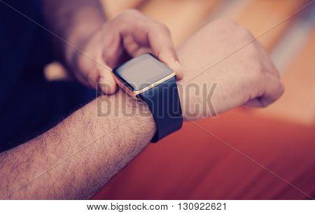 Hands Of Black Man Using Modern Smart Wrist Watch