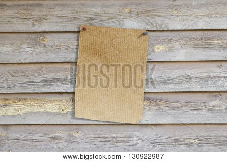Pinned Page On Wooden Wall