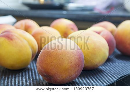 fresh healthy organic peaches in rows over black