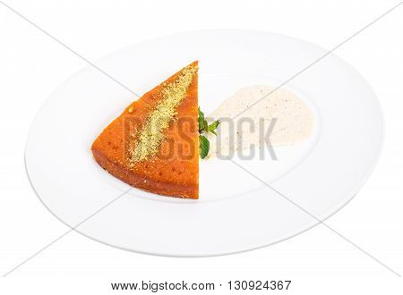 Sweet lemon pie with grated nuts and pistachio mousse. Isolated on a white background.