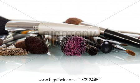 Cosmetic brushes for makeup isolated on white background.