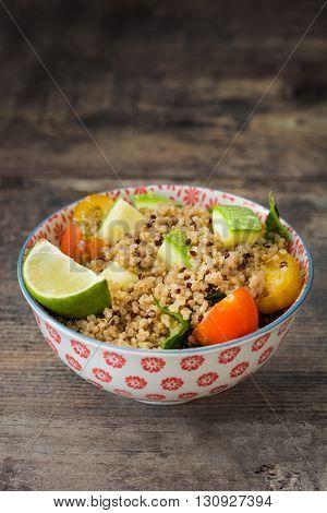 Quinoa salad on a rustic wooden table