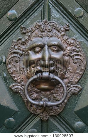 Old and ancient knocker in the city of Prague