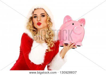 Santa woman holding a piggy bank and sending a kiss