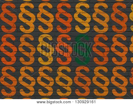 Law concept: rows of Painted orange paragraph icons around green paragraph icon on Black Brick wall background