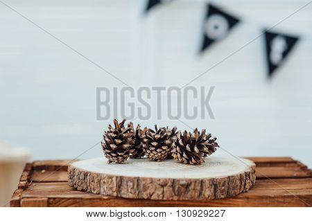 Pine cones on wooden background. Selective focus